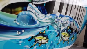 Photo of a glass window in a sea fish ocean graphic wrap