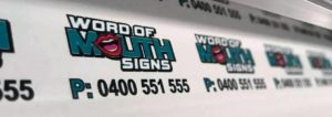 wom signs banner